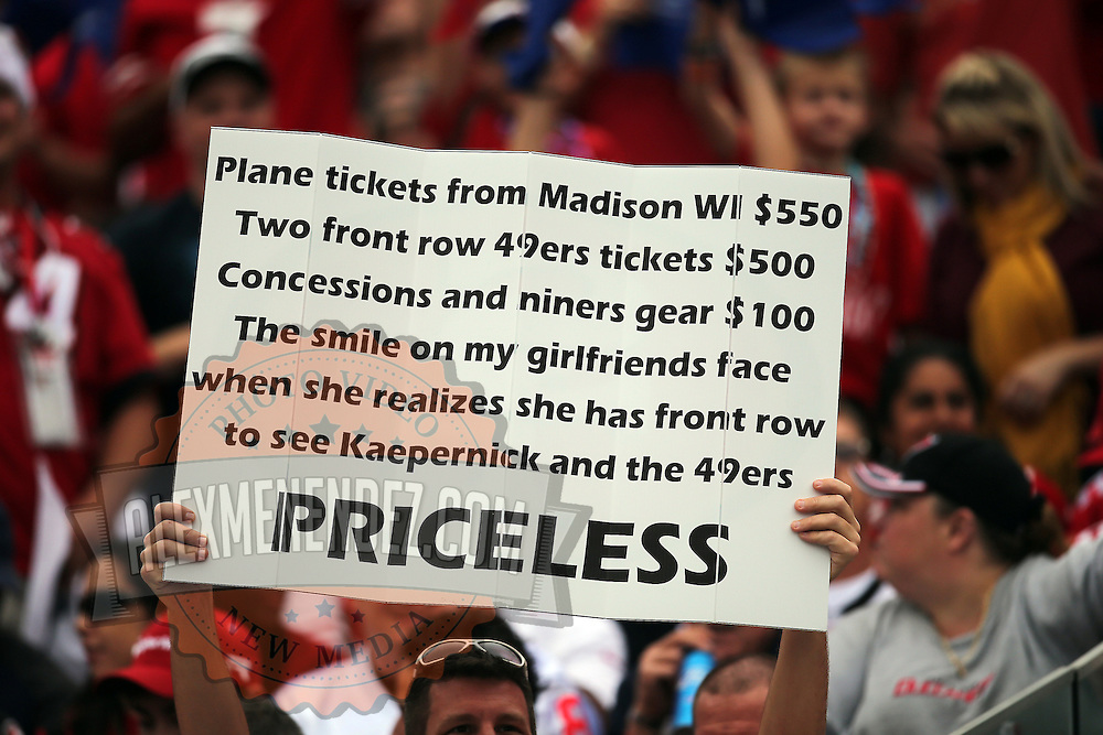 49ers fans hold a sign during an NFL football game between the San Francisco 49ers  and the Tampa Bay Buccaneers on Sunday, December 15, 2013 at Raymond James Stadium in Tampa, Florida.. (Photo/Alex Menendez)