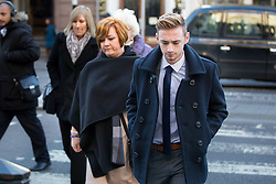 © Licensed to London News Pictures. 17/01/2017. London, UK. Terror attack survivor Owen Richards and mother Suzy Evans arriving at The Royal Courts of Justice for the second day of an inquest into the death of 30 Brits in the Tunisia terror attack. The attack took place is Sousse, Tunisia, when Seifeddine Rezgui killed 38 tourists on a beach outside Imperial Marhaba hotel. Photo credit : Tom Nicholson/LNP