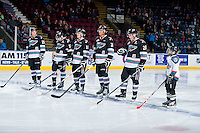 KELOWNA, CANADA - OCTOBER 23: Justin Kirkland #23, Rodney Southam #17, Kole Lind #16, Devante Stephens #21 and Joe Gatenby #28 of Kelowna Rockets line up against the Prince George Cougars with the Pepsi Save On Foods Player of the Game on October 23, 2015 at Prospera Place in Kelowna, British Columbia, Canada.  (Photo by Marissa Baecker/Shoot the Breeze)  *** Local Caption *** Justin Kirkland; Rodney Southam; Kole Lind; Joe Gatenby; Devante Stephens; Pepsi Save On Foods player of the game;