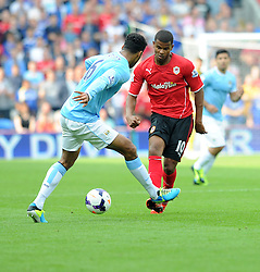 Cardiff City's Fraizer Campbell plays the ball through Manchester City's Joleon Lescott legs.  - Photo mandatory by-line: Alex James/JMP - Tel: Mobile: 07966 386802 25/08/2013 - SPORT - FOOTBALL - Cardiff City Stadium - Cardiff -  Cardiff City V Manchester City - Barclays Premier League