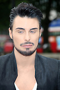 12.JUNE.2013. LONDON<br /> <br /> RYLAN CLARK SHOWS OFF HIS 'XY-FACTOR' IN REVEALING NEW PETA ANTI-FUR ADVERT AT MARBLE ARCH, LONDON<br /> <br /> BYLINE: EDBIMAGEARCHIVE.CO.UK<br /> <br /> *THIS IMAGE IS STRICTLY FOR UK NEWSPAPERS AND MAGAZINES ONLY*<br /> *FOR WORLD WIDE SALES AND WEB USE PLEASE CONTACT EDBIMAGEARCHIVE - 0208 954 5968*