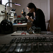 Jennifer Indovina, President, CEO, and co-founder of Tenrehte Technologies, at her home and workspace in Rochester on Tuesday, December 16, 2014.