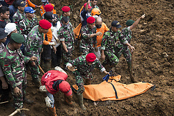 February 6, 2018 - Cijeruk, Jakarta, Indonesia - Bogor, Maseng, Cijeruk, West Java - 5 people were buried from landslide at Maseng-Cijeruk-Bogor-West Java. The landslide happen because heavy rain hit the area and poor construction of the rail way near the houses built below the rail way, causing three houses where 9 people live there, 5 were buried dead from the landslide. Police and Millitary try the evacation since 05 February but still failed to find the bodies. On 6 February 2018 by the help of good sniff from police K9 Dogs 5 bodies were found and managed evacuated. (Credit Image: © Donal Husni via ZUMA Wire)