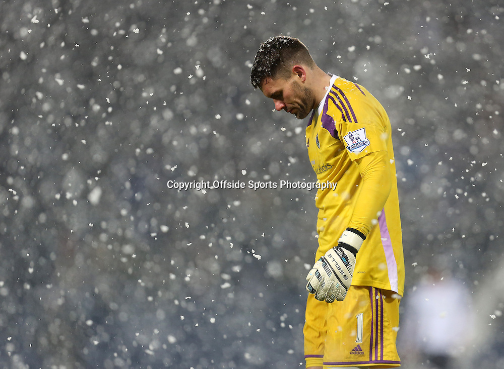 26th December 2014 - Barclays Premier League - West Bromwich Albion v Manchester City - West Bromwich Albion keeper Ben Foster stands as heavy snow falls - Photo: Paul Roberts / Offside.