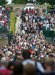 LONDON, ENGLAND - Friday, June 24, 2011: Crowds walk between court during day five of the Wimbledon Lawn Tennis Championships at the All England Lawn Tennis and Croquet Club. (Pic by David Rawcliffe/Propaganda)