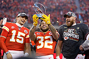 Kansas City Chiefs' Patrick Mahomes, left, Tyrann Mathieu, center, and Travis Kelce, tight, look at the Lamar Hunt Trophy as they celebrate winning the NFL AFC Championship football game against the Tennessee Titans, Sunday, Jan. 19, 2020, in Kansas City, MO. The Chiefs won 35-24 to advance to Super Bowl 54. (Photo/Colin E. Braley)
