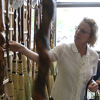 Molly Fleming looks at a spiderweb broom from Georges's Broom Closet Saturday at the Gumtree Festival