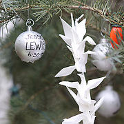 Tributes to the victims left at the shrine set up around the towns Christmas tree in Sandy Hook after the mass shootings at Sandy Hook Elementary School, Newtown, Connecticut, USA. 17th December 2012. Photo Tim Clayton