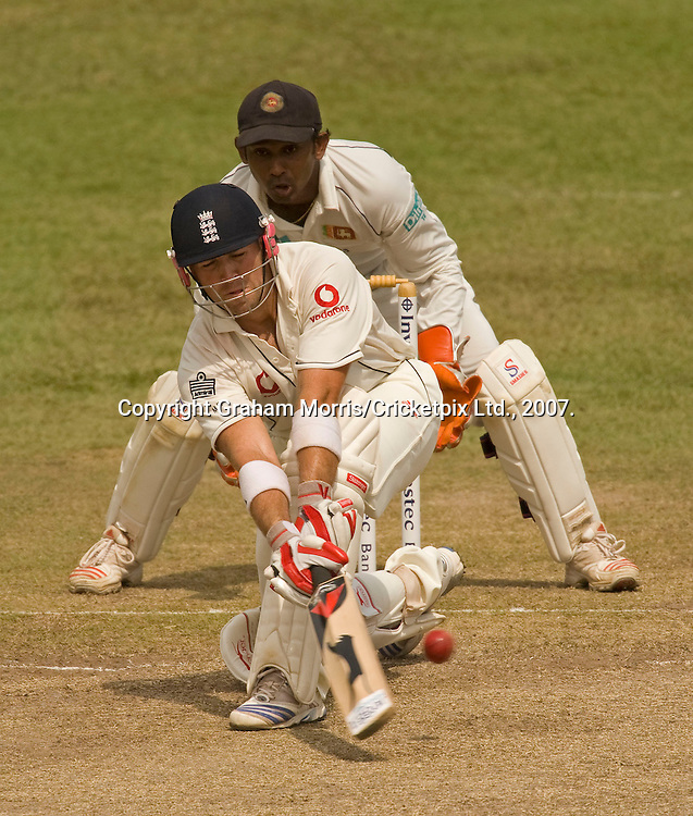 Matthew Prior sweeps Muttiah Muralitharan during the second Test Match between Sri Lanka and England at the SSC in Colombo. Photograph © Graham Morris/cricketpix.com (Tel: +44 (0)20 8969 4192; Email: sales@cricketpix.com)