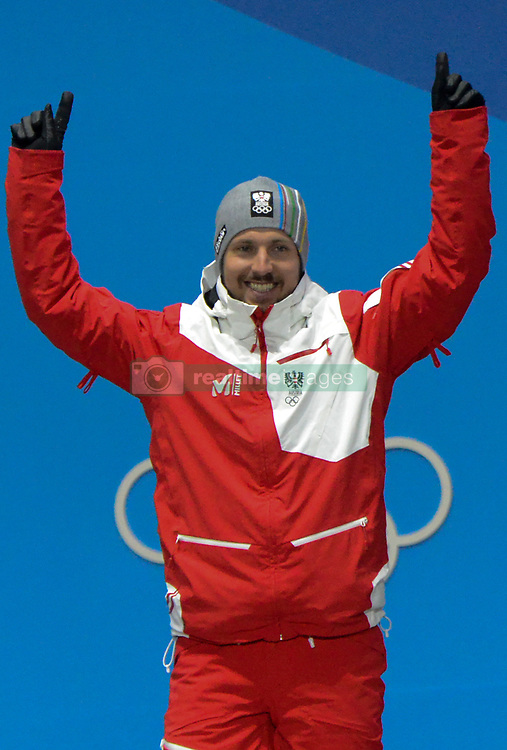 February 18, 2018 - Pyeongchang, South Korea - MARCEL HIRSCHER of Austria celebrates getting the gold medal in the men's Super-G skiing event in the PyeongChang Olympic Games. (Credit Image: © Christopher Levy via ZUMA Wire)