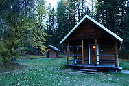 Ford Cabin, a forest service rental cabin in the North Fork Flathead River Valley in fall. Northwest Montana.
