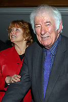 Nobel Laureate Irish poet Seamus Heaney who is this year celebrating his 70th birthday, with his wife, Marie, at a Queen's University Belfast, lunch followed by him being interviewed by broadcaster William Crawley. 200912023169.<br /> <br /> Copyright Image from Victor Patterson,<br /> 54 Dorchester Park, <br /> Belfast, UK, BT9 <br /> <br /> t1: +44 28 9066 1296 (from Rep of Ireland 048 90661296)<br /> t2: +44 28 9002 2446 (from Rep of Ireland 048 9002 2446)<br /> <br /> m: +44 7802 353836<br /> <br /> e: victorpatterson@me.com<br /> www.victorpatterson.com<br /> <br /> Please see my Terms and Conditions of Use at www.victorpatterson.com. It is IMPORTANT that you familiarise yourself with them.<br /> <br /> Images used on the Internet must be visibly watermarked i.e. © Victor Patterson<br /> within the body of the image and copyright metadata must not be deleted. Images <br /> used on the Internet have a size restriction of 4kbs and will be chargeable at current<br />  NUJ rates unless agreed otherwise.<br /> <br /> This image is only available for the use of the download recipient i.e. television station, newspaper, magazine, book publisher, etc, and must not be passed on to any third <br /> party. It is also downloaded on condition that each and every usage is notified within 7 days to victorpatterson@me.com<br /> <br /> The right of Victor Patterson to be identified as the author is asserted in accordance with The Copyright Designs And Patents Act (1988). All moral rights are asserted.