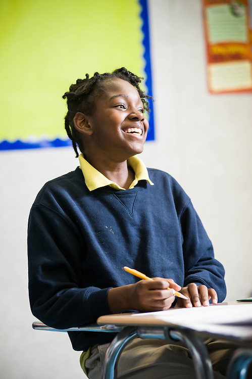 An Epiphany School student smiles during one on one instruction after school.