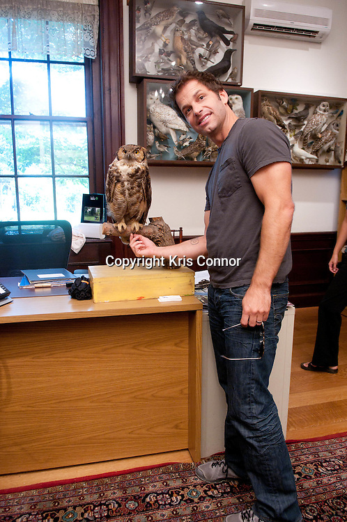 "Director Zack Snyder poses with a replica of an owl during a visit to promote the new Warner Brothers' movie ""Legend of the Guardians: The Owls of Ga'Hoole,"" at the Audubon Naturalist Society Wildlife Sanctury in Chevy Chase, Md on September 14, 2010. Photo by Kris Connor"