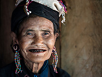 KYAING TONG, MYANMAR - CIRCA DECEMBER 2017: Portrait of old woman at the Pan Ian Village, Enn tribe also known as Eng or Black Teeth around Kyaing Tong
