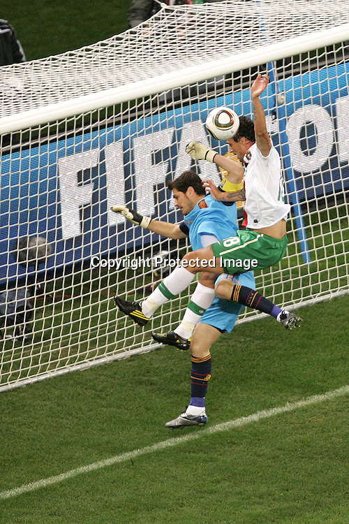 Iker Casillas of Spain and Hugo Almeida of Portugal battle for the ball during the FIFA World Cup 2010 last 16 match between Spain and Portugal held at The Cape Town Stadium in Green Point, Cape Town, South Africa on the 29th June 2010<br /> <br /> <br /> Photo by Ron Gaunt/SPORTZPICS