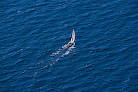 A lone sailboat off the coast of California