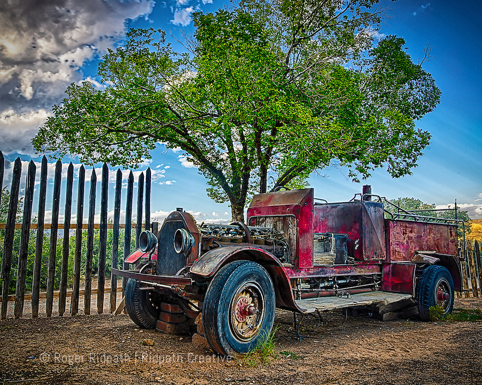 old fire truck by tree