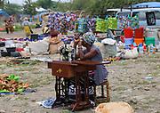 Seamstress with manual sewing machine awaits customers at the Frontier Market, Tanzania