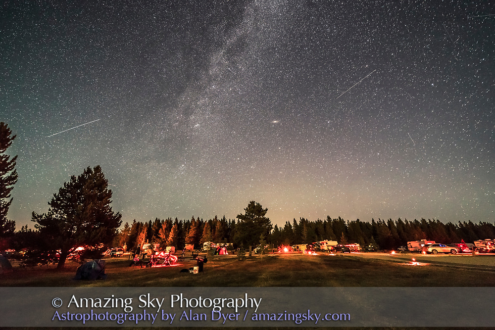 The autumn constellations rising in the east over the main observing field at the annual Saskatchewan Summer Star Party, August 26, 2017, with the crescent Moon providing some of the ground illumination. <br /> <br /> A bright satellite trail is at left. Two others are at right. Andromeda and M31 are at centre. <br /> <br /> This is a single exposure of 30 seconds with the Canon 6D MKII at ISO 3200 and Rokinon 14mm SP lens at f/2.5.