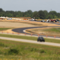 Paving crews work to complete the new interchange at U.S. Highway 6 and Thomas Street in Tupelo.