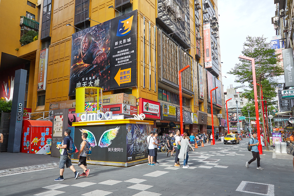 Pedestrians walk through the streets of Ximending. The area is popular with both tourists and locals, offering a mix of food, shopping and cinemas.
