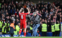 Liverpool skipper steven Gerrard celebrates the win in fornt of the travelling Kop<br />