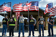 Members of the Patriot Guard Riders stand outside during the funeral for Army Pfc. Weldon Alonzo Davis, a Korean War soldier who died as a POW in 1951, at the Dallas-Fort Worth National Cemetery on Wednesday, February 6, 2013 in Dallas, Texas. (Cooper Neill/The Dallas Morning News)