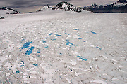 Melt water pools on the top of the Marinelli glacier in the Darwin Range of the Andes Mountains, Chile, Jan. 23, 2004. Daniel Beltra/Greenpeace.