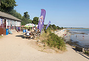 Early morning quiet at beach cafe, Studland Bay, Swanage, Dorset, England, UK