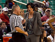 Miami coach Katie Meier shows her displeasure of a call to ACC Women's Basketball Official Bryan Brunette during their 93 - 85 win over NC State in the second round of the 2011 ACC Women's Basketball Tournament held at the Greensboro Coliseum in Greensboro, North Carolina.  (Photo by Mark W. Sutton)