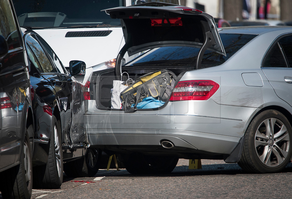 © Licensed to London News Pictures. 13/04/2019. London, UK.  Items in the boot of a damaged car at the scene in Holland Park after shots were fired near the Ukrainian embassy. Photo credit: Ben Cawthra/LNP