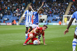Jordan Houghton of Milton Keynes Dons goes down in the box under pressure from Sam Saunders of Colchester United - Mandatory by-line: Arron Gent/JMP - 27/04/2019 - FOOTBALL - JobServe Community Stadium - Colchester, England - Colchester United v Milton Keynes Dons - Sky Bet League Two