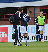 Thomas Konrad is helped off after falling awkwardly - Dundee v Inverness Caledonian Thistle in the Ladbrokes Premiership at Dens Park<br /> <br />  - &copy; David Young - www.davidyoungphoto.co.uk - email: davidyoungphoto@gmail.com