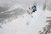 All around Whistler snowboarder Chris Rasman does a method off a snowy cliff in the side country at Whitewater Ski Resort near Nelson, BC