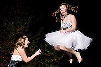 Felicia Pollos and Katie Mills play on the trampoline before the Coeur d'Alene High homecoming dance Saturday, Oct. 15, 2011.