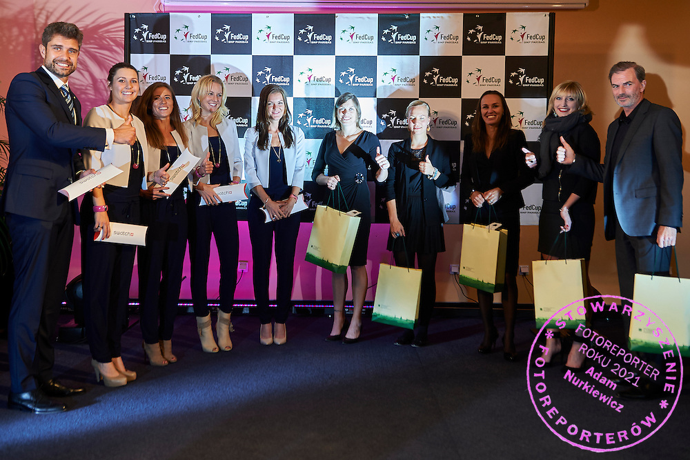 (L-R) Tomasz Wiktorowski - captain national team and Klaudia Jans-Ignacik and Alicja Rosolska and Urszula Radwanska and Agnieszka Radwanska all from Poland and Romina Oprandi and Viktorija Golubic and Martina Hingis and Timea Bacsinszky Heinz Guenthardt - captain national team all from Switzerland during official dinner on two days before the Fed Cup / World Group Play Off tennis match between Poland and Switzerland at The Zielona Gora Palm House on April 16, 2015 in Zielona Gora, Poland<br /> Poland, Zielona Gora, April 16, 2015<br /> <br /> Picture also available in RAW (NEF) or TIFF format on special request.<br /> <br /> For editorial use only. Any commercial or promotional use requires permission.<br /> <br /> Adam Nurkiewicz declares that he has no rights to the image of people at the photographs of his authorship.<br /> <br /> Mandatory credit:<br /> Photo by &copy; Adam Nurkiewicz / Mediasport
