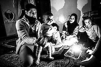 A family spend a night with a candle, drinking coffee without any electricity provided in Aleppo, Syria.