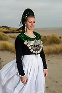 Kerstin, member of a Folklore Association of the island of F&ouml;hr is wearing an original traditional bridal costume on F&ouml;hr, Schleswig Holstein, Germany on December 9, 2016.<br /> <br /> Kerstin has made the white apron herself, but from dress to jewelry, adornments and blouse, everything else is heirloom of her grandmother and great grandmother. She has worn this dress to her wedding and she is still wearing the dress about twice a week.<br /> <br /> This is part of the series about Traditional Wedding Gowns from different regions of Germany, worn by young members of local dance groups and cultural associations that exist to preserve and celebrate the cultural heritage. The portraiture series is a depiction of an old era with different social values and religious beliefs in an antiquated civil society with very few of those dresses left.