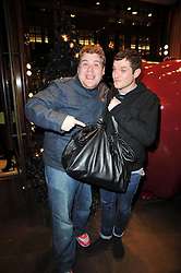Left to right, JAMES CORDEN and MATTHEW HORNE at a party to celebrate the launch of the new Mulberry leather case for Apple's iPhone held at the Mulberry store, Bond Street, London on 5th November 2009.