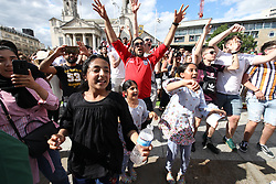 © Licensed to London News Pictures . 07/07/2018. Leeds, UK. Football fans celebrate England's victory over Sweden in the World Cup in Leeds City Centre . Photo credit: Joel Goodman/LNP