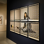 Smithsonian National Museum of African Art Lalla Essaydi Photography Exhibit. Part of a photography exhibit by Moroccan-born artist Lalla Essaydi at the Smithsonian African Art Museum. This section of the exhibit is titled Les Femmes de Maroc; the full display is titled Revisions. The Smithsonian National Museum of African Art was opened at its current location in 1987 as a mostly underground facility behind the Smithsonian Castle on Washington DC's National Mall. It is dedicated to ancient and contemporary African art. EDITORIAL USE ONLY.