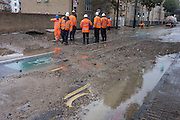Waters subside leaving a mess of silt and stones after a main water main burst on Camberwell New Road, Southwark, London.