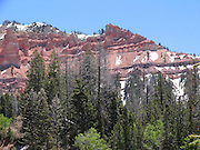 Snow still covers sections of a red rock mountain in this photograph of Bryce Canyon National Park taken on June 13, 2005 in Bryce Canyon National Park, Utah. ©Paul Anthony Spinelli