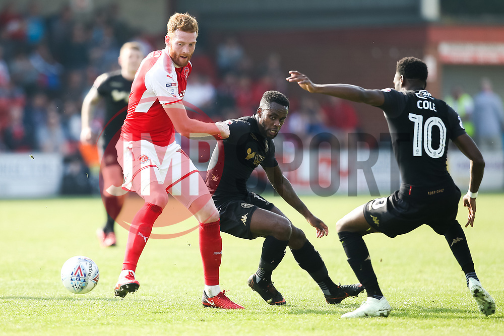 Gavin Massey of Wigan Athletic takes on Cian Bolger of Fleetwood Town- Mandatory by-line: Robbie Stephenson/JMP - 21/04/2018 - FOOTBALL - Highbury Stadium - Fleetwood, England - Fleetwood Town v Wigan Athletic - Sky Bet League One
