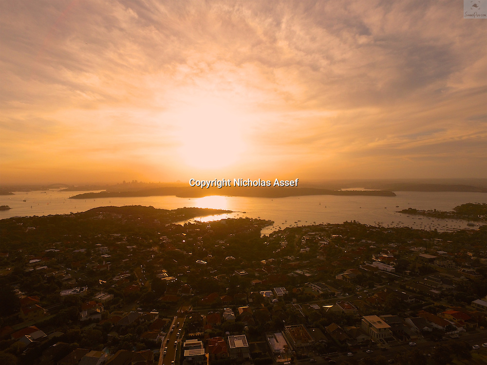 Looking west over Sydney Harbour into a reddening sunset