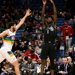 Feb 12, 2019; New Orleans, LA, USA; Orlando Magic forward Jonathan Isaac (1) shoots over New Orleans Pelicans guard Kenrich Williams (34) during the first quarter at the Smoothie King Center. Mandatory Credit: Derick E. Hingle-USA TODAY Sports
