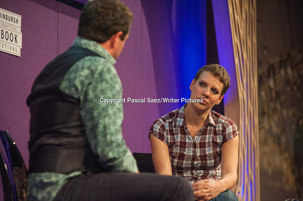 Francesca Martinez (right), British stand-up comedian, actress and writer, on stage at the Edinburgh International Book Festival. 22nd August 2014.<br />On the left of the image is comedian and writer Mark Thomas, who was chairing the event.<br /><br />Photograph by Pascal Saez/Writer Pictures <br />WORLD RIGHTS