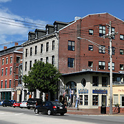 19th Century architecture typical to Commercial Street which runs along the waterfront of Portland, Maine, USA. A fire in 1866 destroyed much of Portland which was rebuilt in a Victorian style. Many of these old buildings now house boutiques and restaurants.