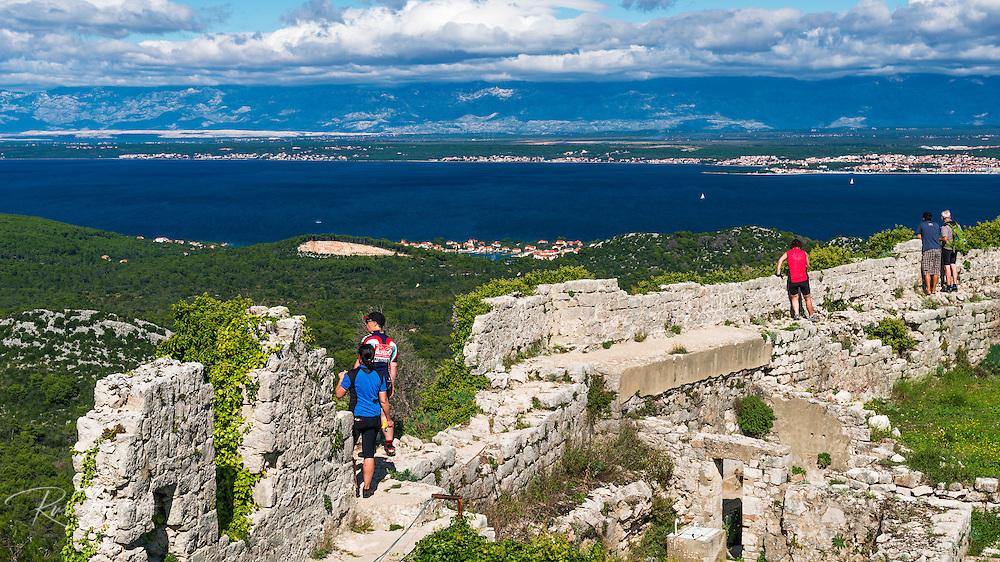 Tourists at St. Michael's Fort (13th Century Venetian ruins) Ugljan Island, Dalmatian Coast, Croatia